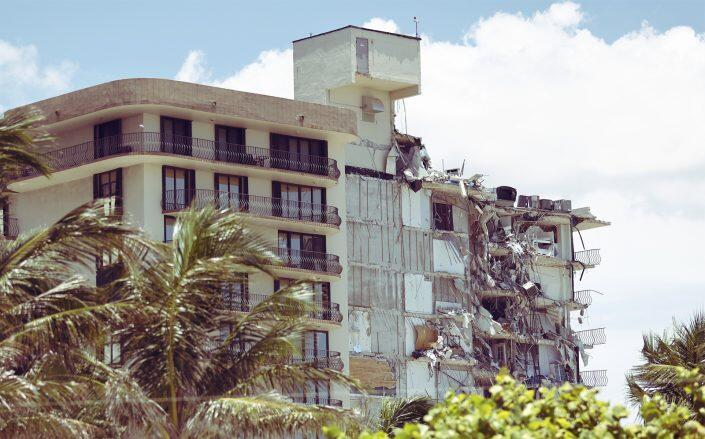 The partially collapsed condo building prior to full demolition (Getty)