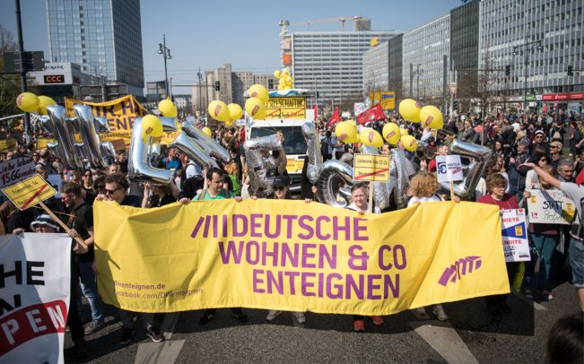 Demonstrators are seen in Berlin's Alexanderplatz protesting the city's rising rent prices in April 2019 (Credit: Getty Images)