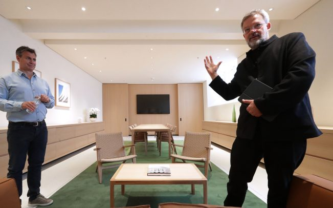 Architect Stefan Behling (right) and Senior Director for Apple Retail and Design Chris Braithwaite talk about the Board Room, as part of Apple Carnegie Library in Washington, DC (Credit: Getty Images)
