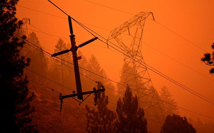 Power lines that were partially burned by the Dixie fire (Getty)