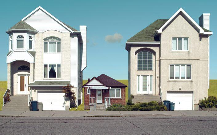 Hauppauge neighbors are perturbed by this small house on an undersized lot. (Getty, Photo Illustration for The Real Deal)