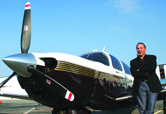 Architect Ross Adam Cole with his four-seater Mooney
