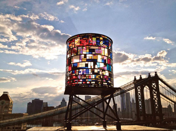 "Artist Tom Fruin's ""Watertower"" on the rooftop at Two Trees' 20 Jay Street in Dumbo, a neighborhood where the firm has established itself as a patron of the arts."