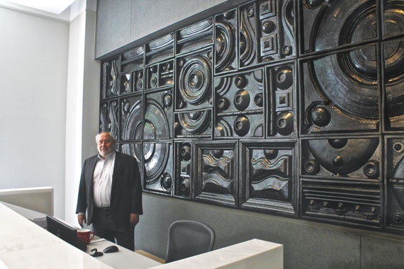 Developer Yitzchak Tessler in the sales gallery of 172 Madison with a piece of art that will soon be installed at the condo tower.