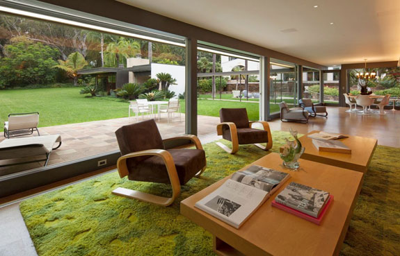 at-the-time-neutra-built-the-residence-for-stuart-and-lucia-bailey-creating-a-clean-and-crisp-living-room-that-includes-floor-to-ceiling-glass