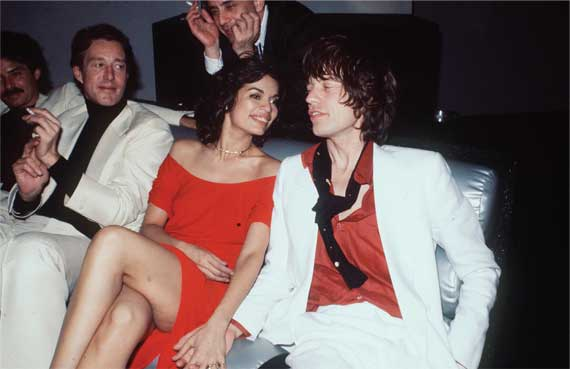 Halston, left, seated next to Bianca and Mick Jagger