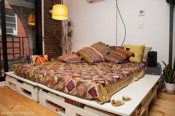 my-days-are-extremely-high-octane-she-said-so-coming-home-is-like-a-deep-breath-of-fresh-air-this-day-bed-on-the-main-level-of-the-apartment-serves-both-as-a-bohemian-style-seating-area-and-storage