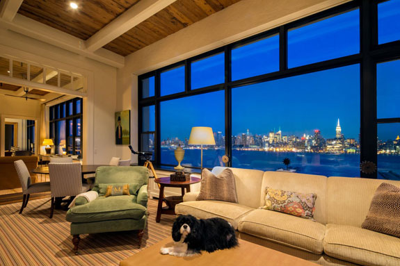 the-three-bedroom-triple-unit-condo-is-laid-out-to-maximize-the-view-windows