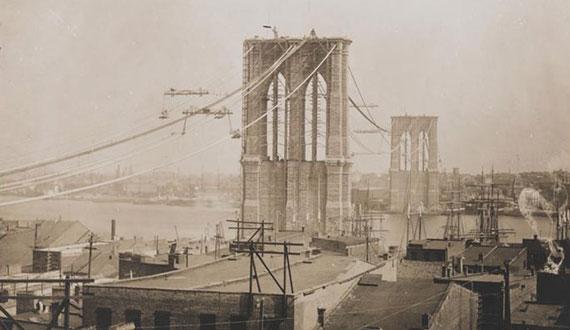 The Brooklyn Bridge under construction