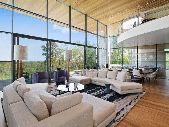 inside-floor-to-ceiling-windows-offer-stellar-views-the-20-foot-glass-front-living-room-wall-gives-you-the-feeling-of-being-part-of-the-outdoor-environment-fontini-said