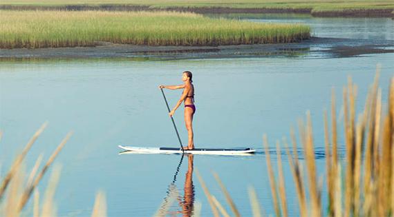 Gina Bradley paddleboarding (Credit: Paddle Diva)