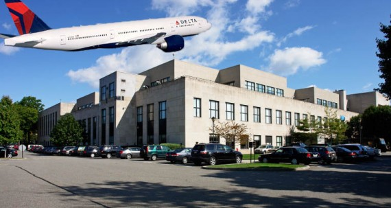A Delta airplane and the Bulova Corporate Center at 75-20 Astoria Boulevard