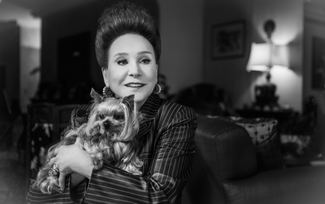 Cindy Adams with her treasured Yorkie, Juicy, photographed in her Park Avenue penthouse.