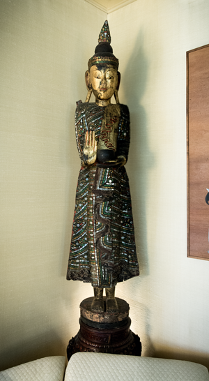 An antique gold wooden Buddha from Burma
