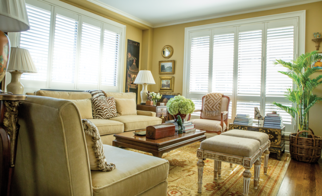A contemporary sofa and chairs from Pottery Barn are paired with more traditional furnishings in Gunn's living room.