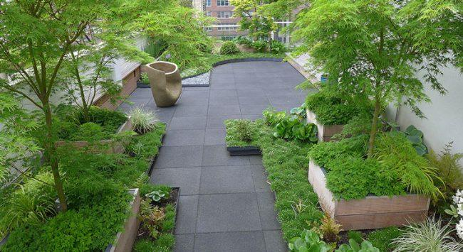 Low planters complement larger boxes with trees and grasses on an Upper West Side terrace landscaped by Jeff Mendoza.