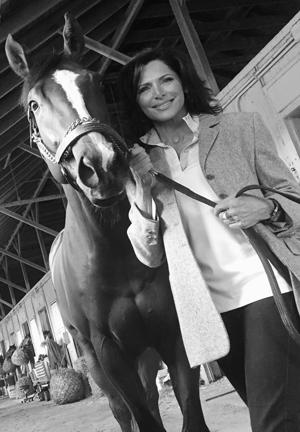 Rosenblum with her horse Champion of the Nile, American Pharaoh's half brother.