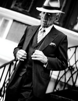 Talese descends the stairs outside his home.