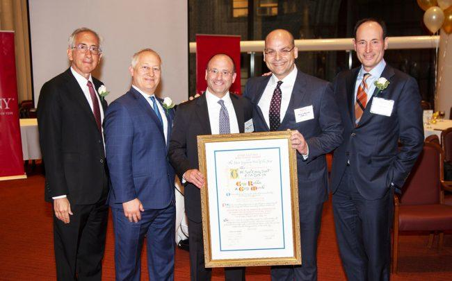 CBRE's Gregg Rothkin and Gerry Miovski (middle) at REBNY's annual cocktail party Tuesday evening.