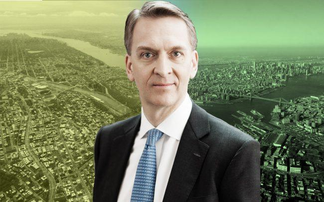 Brookfield CEO Bruce Flatt with an aerial of the Bronx (left) and Brooklyn (right)