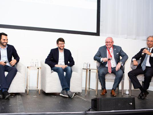 From left: Industrious CEO Jamie Hodari, Common CEO Brad Hargeaves, Cushman & Wakefield's Global Brokerage chairman Bruce Mosler and Newmark Group CEO Barry Gosin (Credit: Emily Assiran)