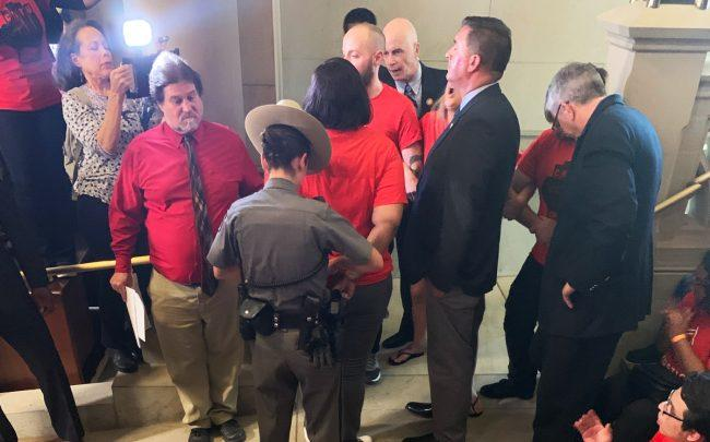 Tenant protesters were arrested in Albany on Tuesday as legislators consider a nine-bill package on rent reform. (Photo by Georgia Kromrei/TRD)