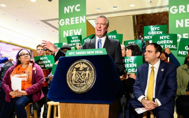 Mayor Bill de Blasio seen speaking during a Green New Deal rally last spring (Credit: Getty Images)