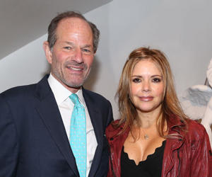 Eliot Spitzer and Roxana Girand (Credit: Getty Images)