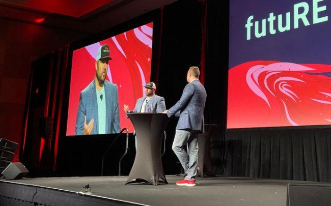 Jeff Cohn and Josh Team, president of KW, on/stage at futuRE