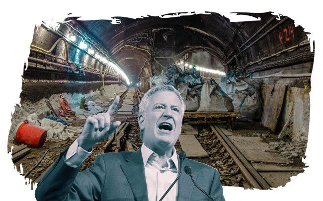 Mayor Bill de Blasio and subway damage caused by Hurricane Sandy (Credit: Getty Images)