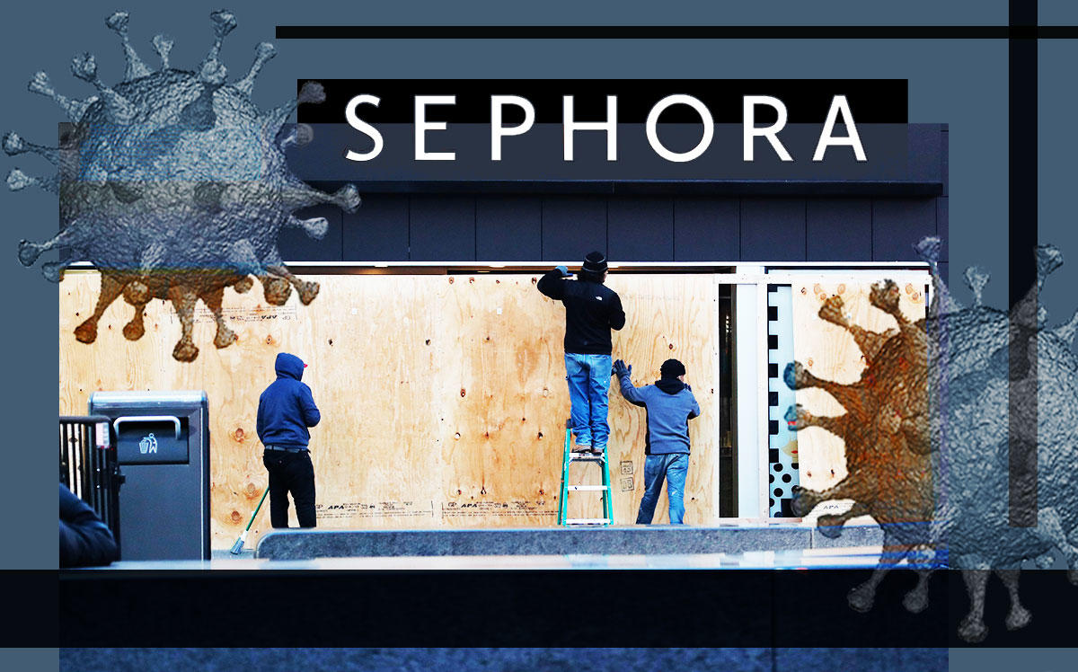 Workers board up the Time Square Sephora location (Credit: Liao Pan/China News Service via Getty Images)