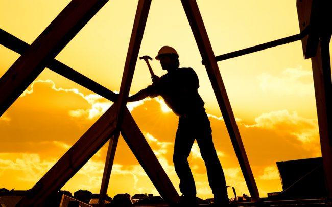 U.S. housing starts and permits are up from last year, but experts say the coronavirus could hit construction hard. (Credit: iStock)