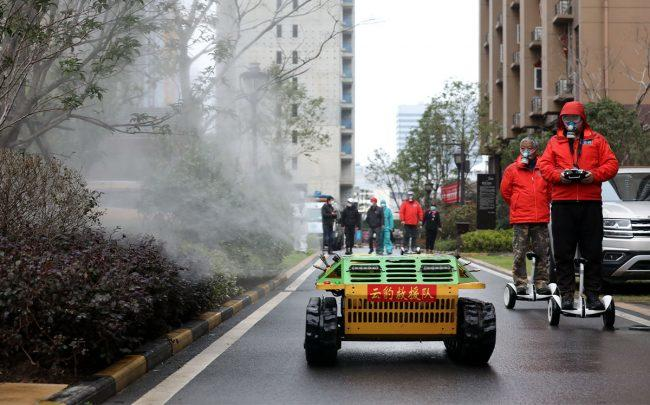 Workers disinfect an apartment complex in Wuhan (Credit: Feature China/Barcroft Media via Getty Images)