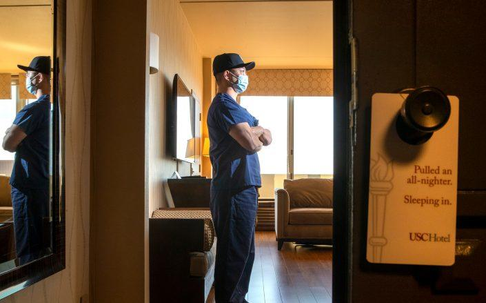 An essential worker staying at USC Hotel in Los Angeles (Credit: Robert Gauthier / Los Angeles Times via Getty Images)