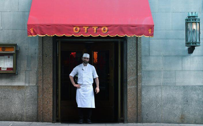 The executive chef of Otto Enoteca stands in front of the closed restaurant caused by the coronavirus pandemic. (Photo by ANGELA WEISS/AFP via Getty Images)