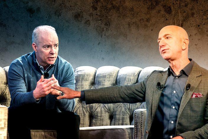 Realogy CEO Ryan Schneider and Amazon CEO Jeff Bezos (Credit: Bezos via Paul Morigi/Getty Images for Amazon)