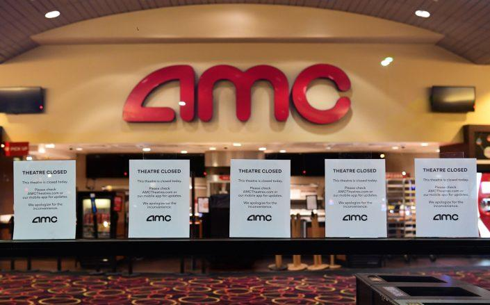 AMC is pressed to get eyes back in front of their screens starting in July — but not without some cuts ahead. (Getty)