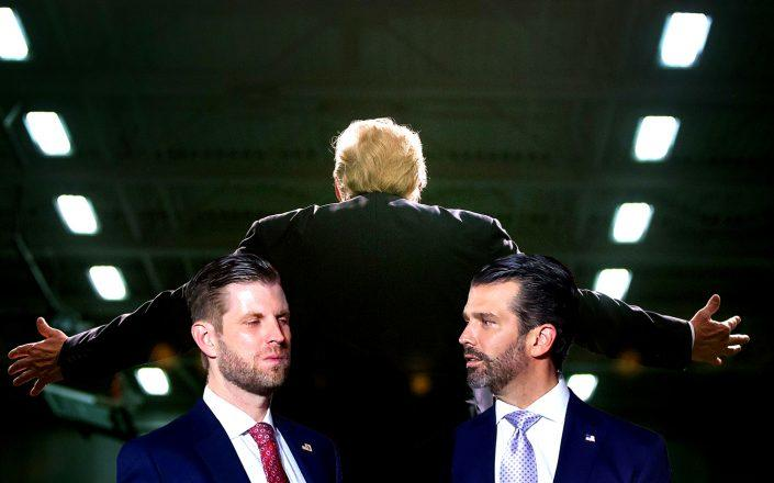 Eric Trump and Donald Trump Jr. with President Donald Trump (Getty)