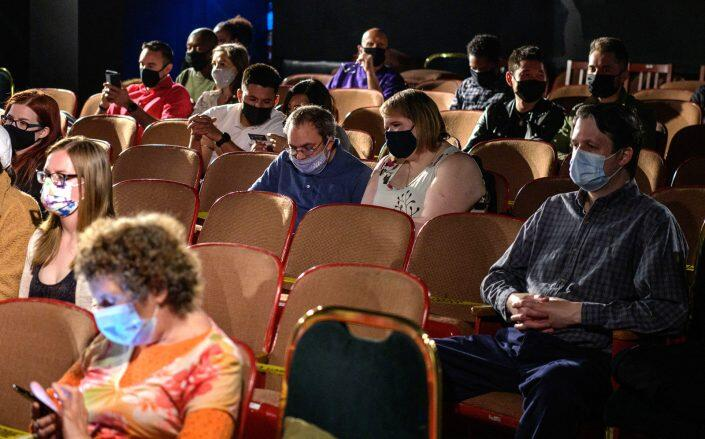 The audience watches a play at The Anne Bernstein Theater in The Theater Center (Getty)
