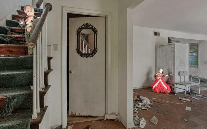 One of the many listing photos with dolls for the New Orleans house (NOLA Living Realty)